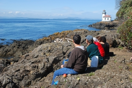 Students near lighthouse in Friday Harbor