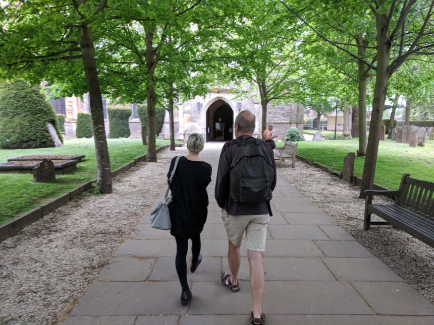 Jessica Burstein and Peter Buckroyd approaching Shakespeare's grave in Stratford.  Photo Owen Crandall