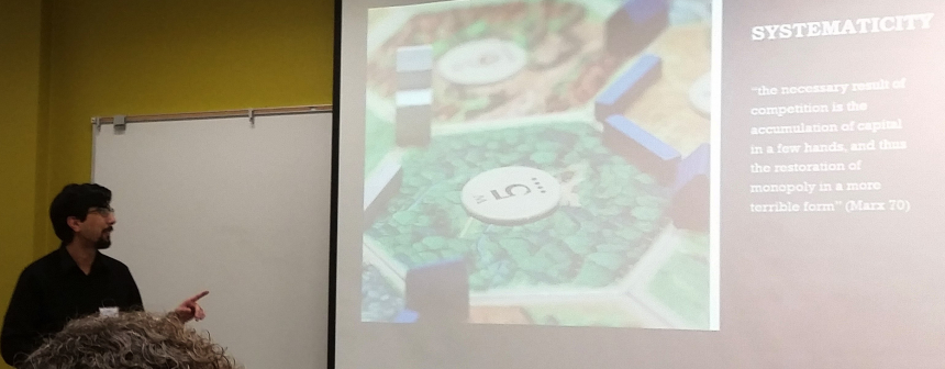 a presenter points to an image of a board game