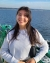 Photo shows dark-haired woman on a ferry