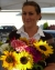 Photo of Natalie with sunflowers