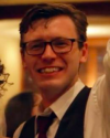 Profile picture of Jacob Oliver, smiling and waving