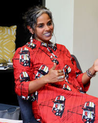 Dr. Anu in a red dress in conversation