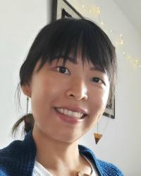 A headshot of a woman smiling at the camera