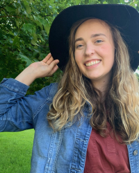photo of Amelia Lehosit in front of a tree wearing a hat